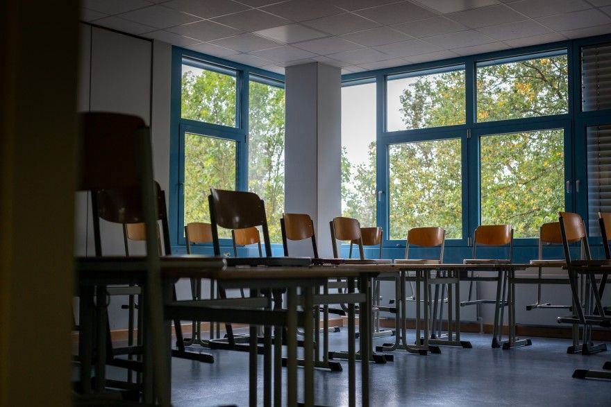 An empty classroom at a high school in Bruhl, Germany. Schools across the country are closed again despite early success in getting children back into classrooms during the pandemic. Image by Ryan Delaney. Germany, undated.