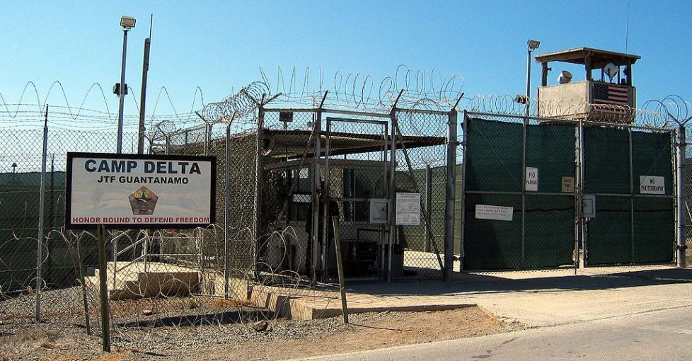 The entrance to Camp 1 in Guantanamo Bay's Camp Delta. The base's detention camps are numbered based on the order in which they were built, not their order of precedence or level of security. Image by Kathleen T. Rhem/Wikimedia Commons. Cuba, 2005.