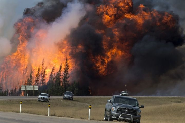 A wildfire burns near Fort McMurray, Alberta, Canada, on May 7. Image courtesy of Premier of Alberta/flickr.