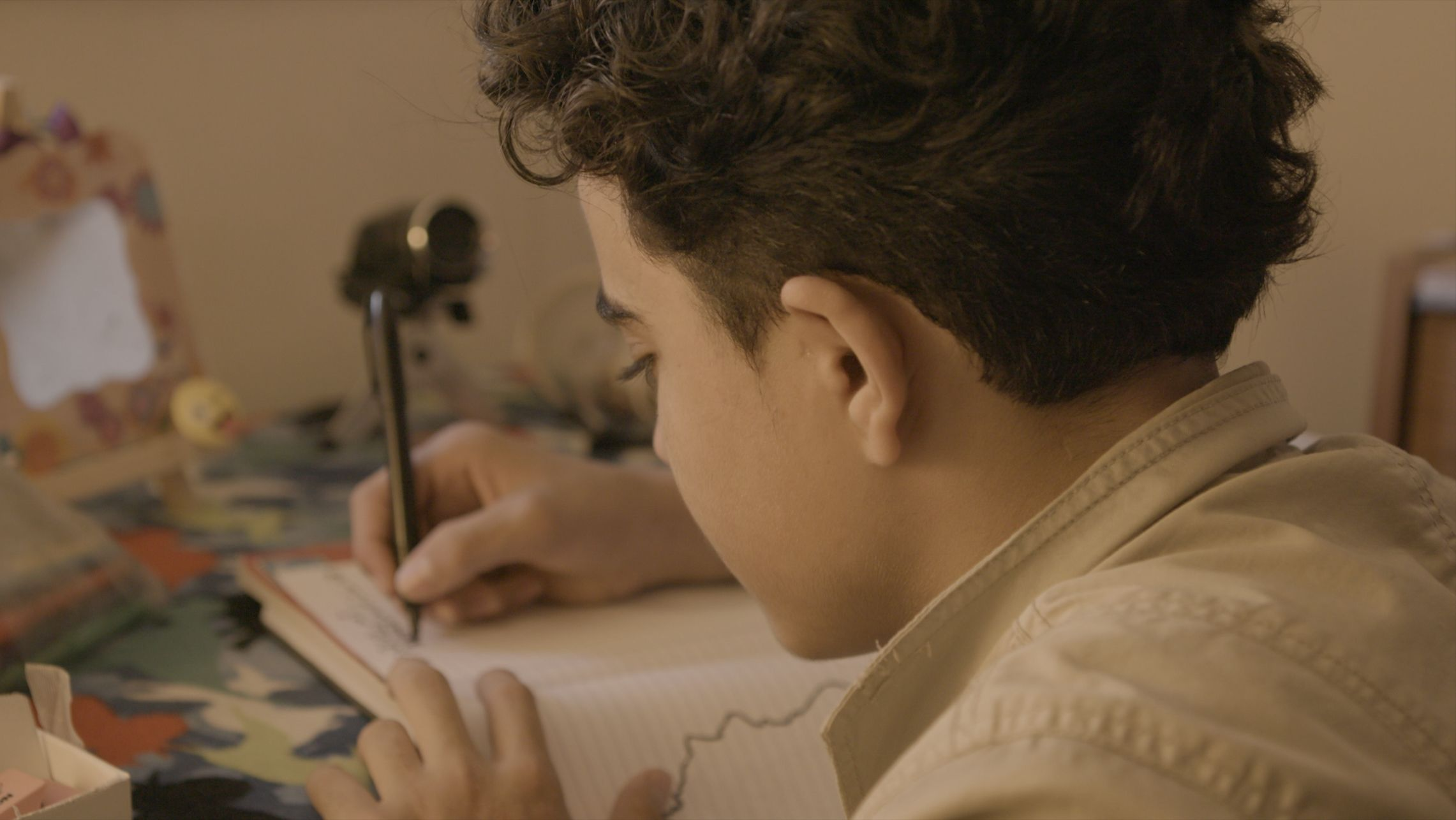 We Became Fragmentsfollows Syrian refugee Ibraheem Sarhan through his first week of 10th grade in Winnipeg. It's a story about loss, resilience, and one young man's identity as he adapts to a new country while his home is at war.