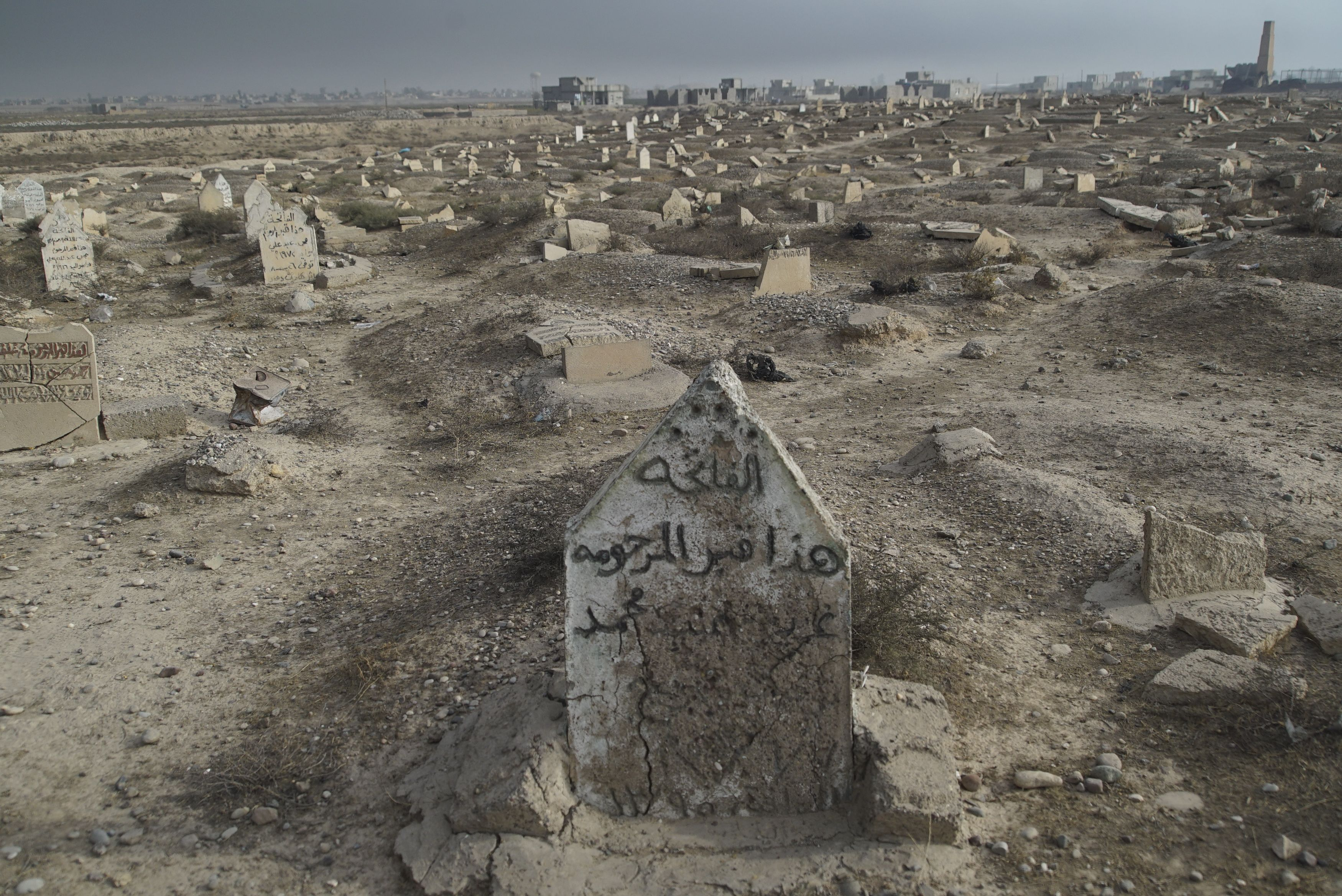 Cemetery destroyed by ISIS in Qayyarah town. Image courtesy of Wikimedia Commons. Iraq, 2016.