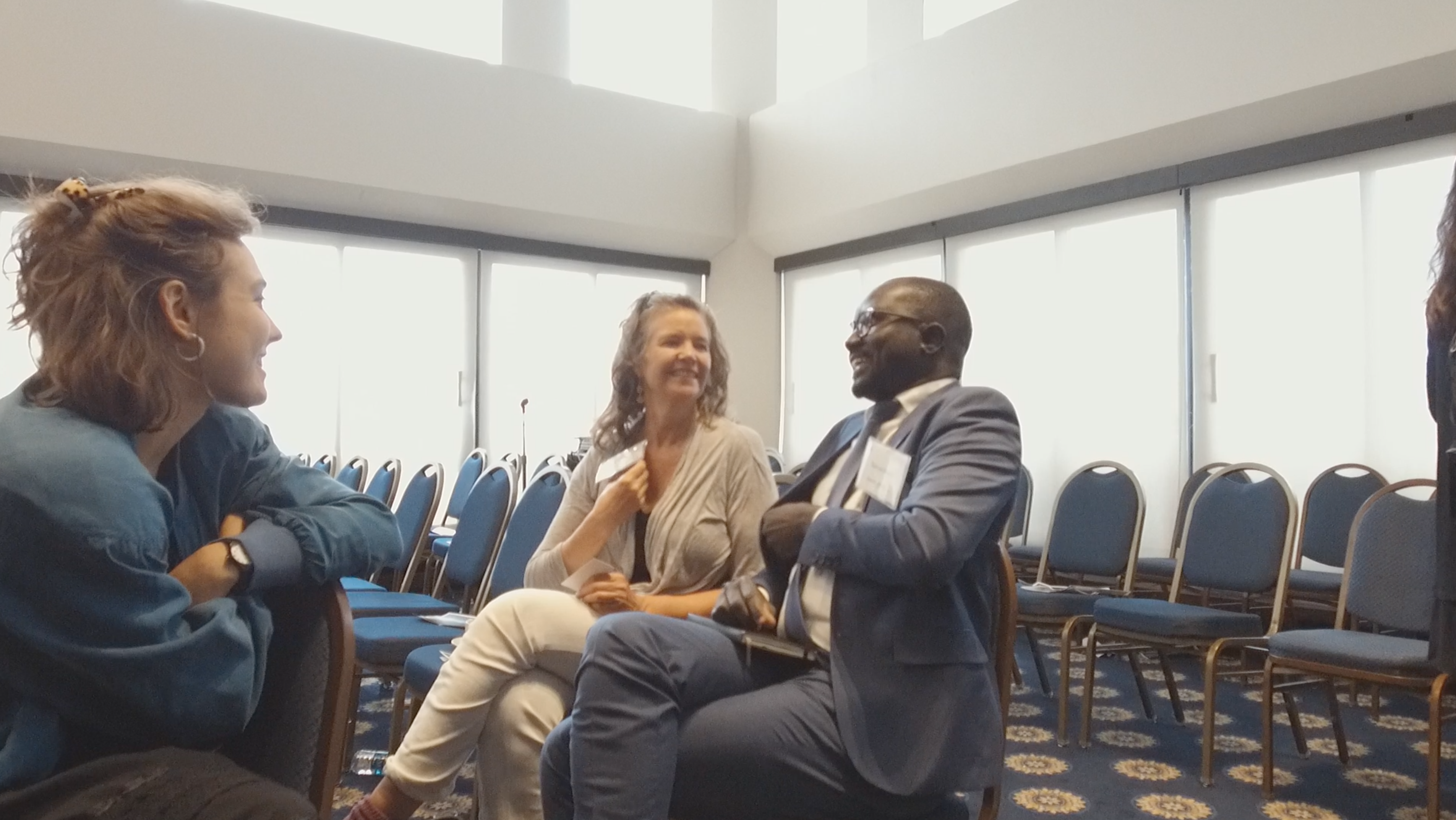 Teaching Partners Alexandra and Laura Marie discuss the panel with conference participant. Image by Dominique Green. Washington, D.C., 2019.