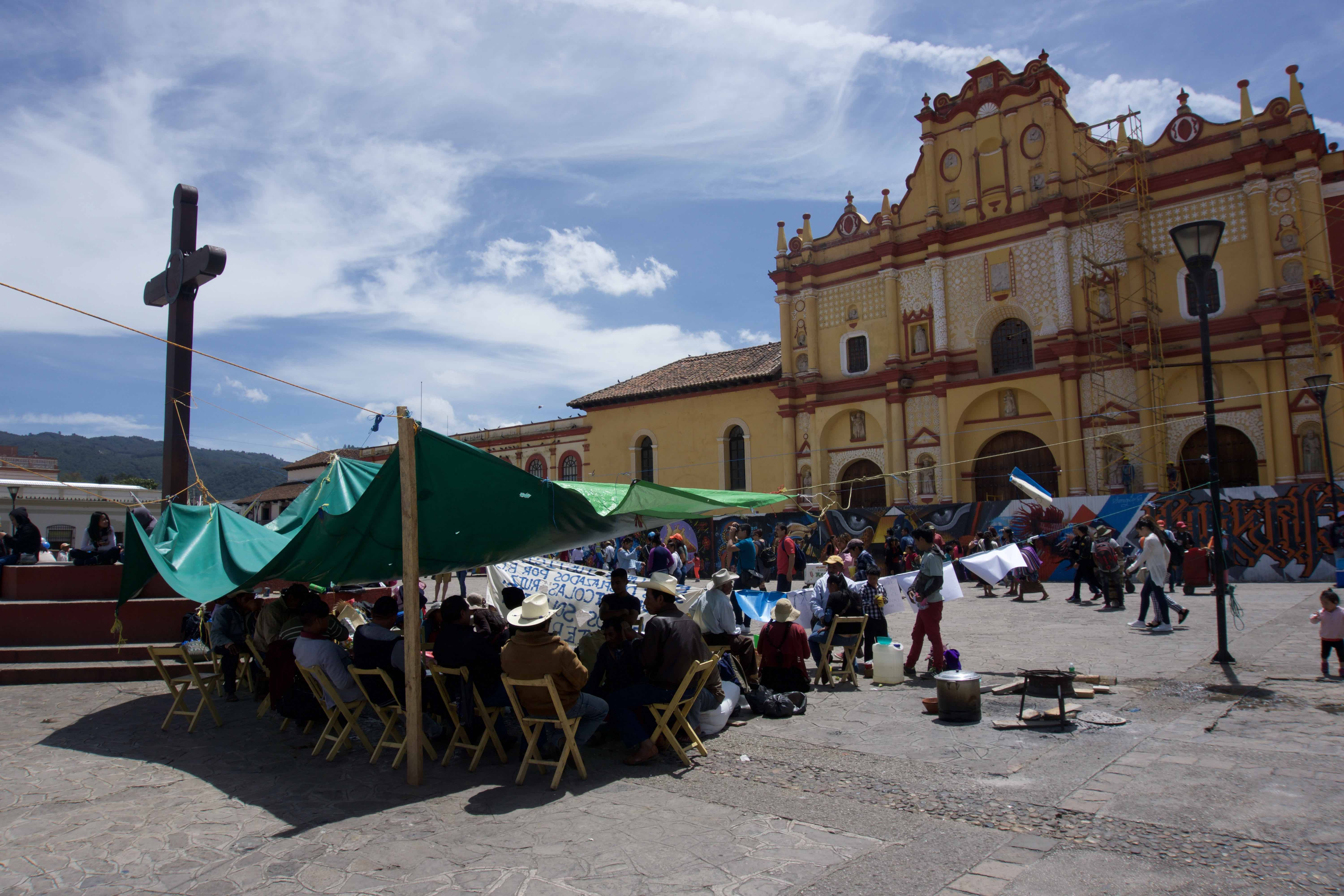Forced from their village by armed invaders, the people of Nicolas Ruiz have set up camp in the center of San Cristobal de las Casas. They live in a makeshift tarp ill-fitted to protect them from the elements.Image by Jared Olson. Mexico, 2018.