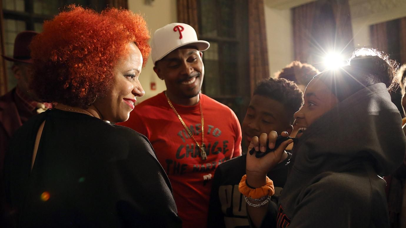Nikole Hannah-Jones talks with a student at the University of Chicago's Institute of Politics 1619 event. Image by Dylan Burrus, Courtesy of the University of Chicago's Institute of Politics. United States, 2019.