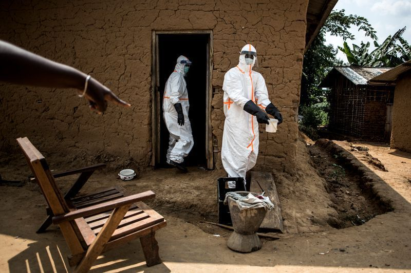 Ebola responders disinfect a home in Aloya in which three people have died. Image by John Wessels. Democratic Republic of Congo, 2019.