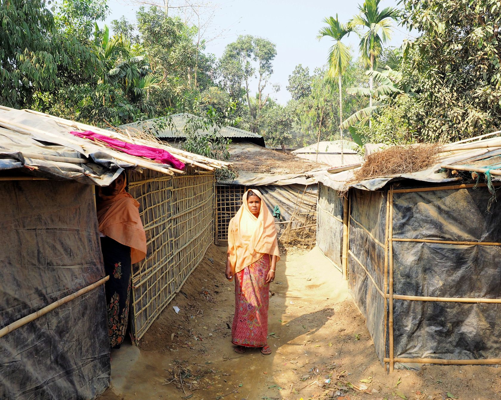A woman in Kutupalong Refugee Camp. Since August, nearly half a million Rohingya have escaped over the Myanmar border to Bangladesh. Image by Doug Bock Clark. Bangladesh, 2017.