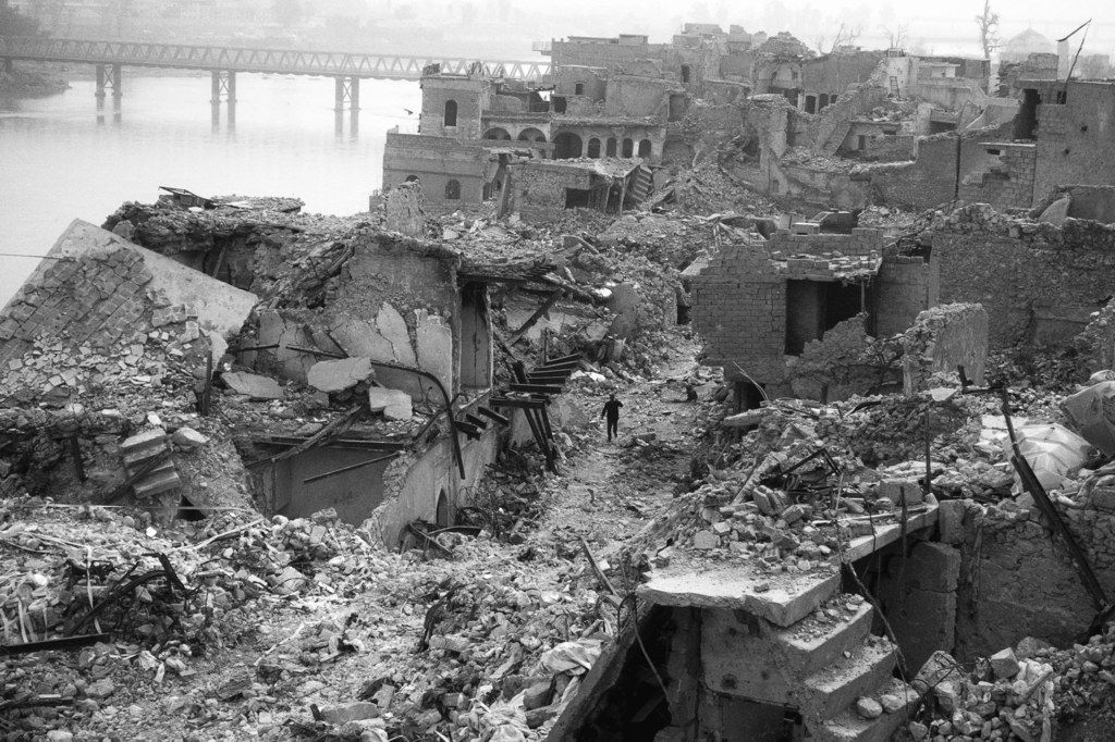 A year and a half after the battle, Mosul's Old City is still in ruins, and unexploded bombs regularly kill people. Ten million tons of rubble remain. Image by Moises Saman / Magnum for The New Yorker. Iraq, 2018.