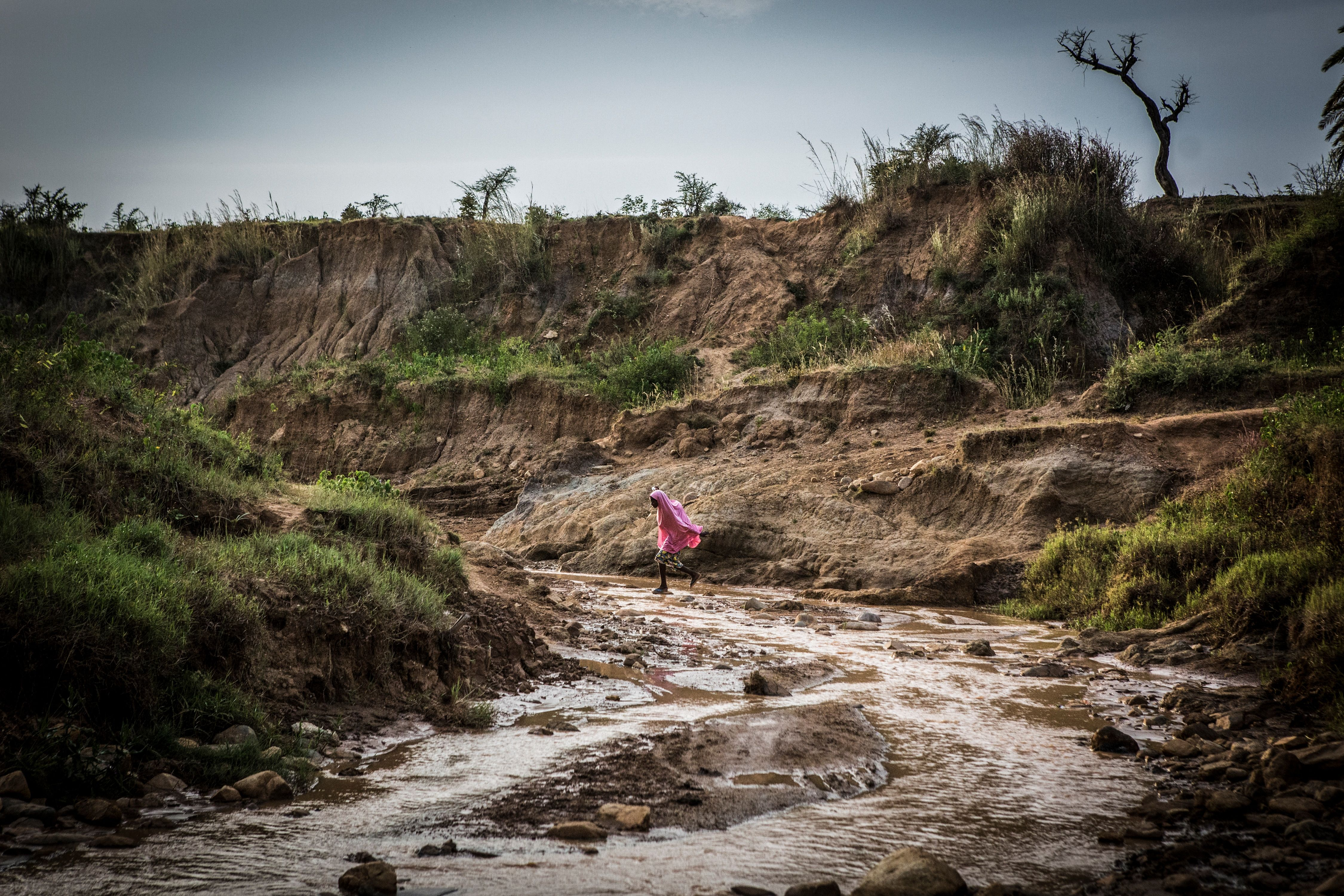 A stream near Nghar Village in Nigeria's Gashish District, where more than 200 people were killed in June by men thought to be cattle herders. Those killed were part of the farming community, which uses land the herders covet. Image by Jane Hahn. Nigeria, 2018.