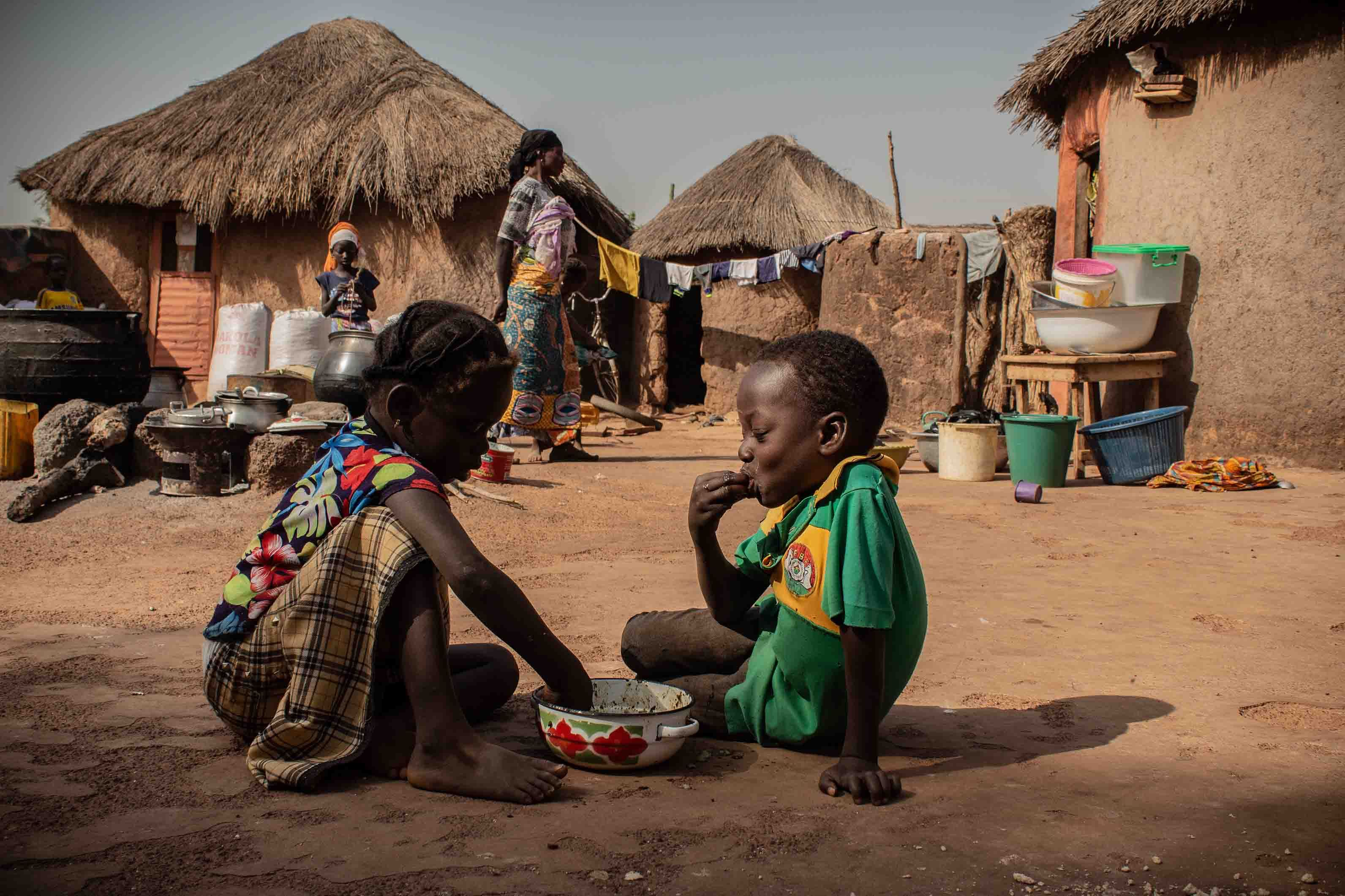 Children in Alimatu Alidu's household, shown here, enjoy a dish made from cowpea. Image by Ankur Paliwal. Ghana, 2019.