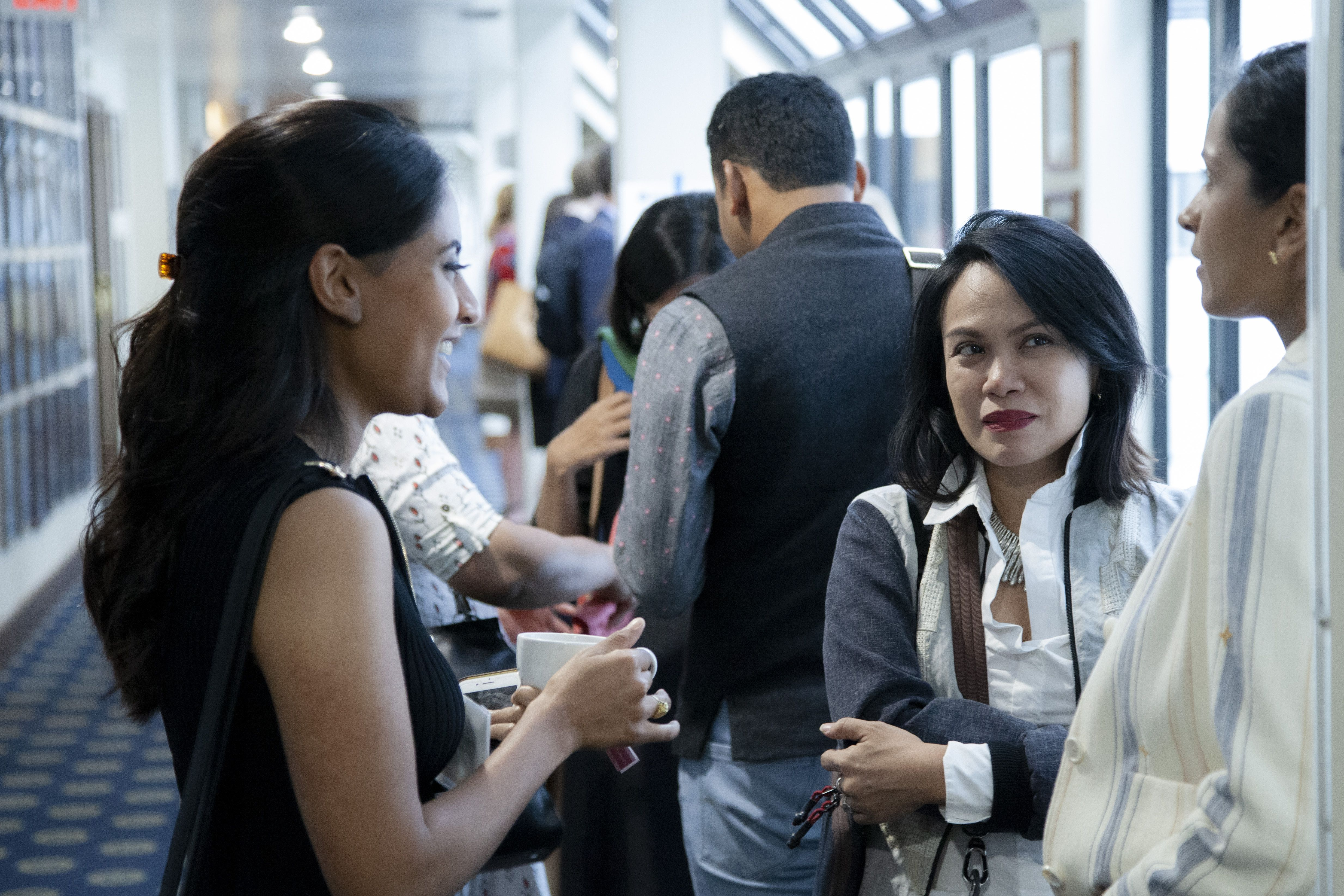 In between panels, journalist grantees Ana Santos (center) and Krithika Varagur (left) chat over coffee with journalist grantee Sushma Subramanian. Image by Jin Ding. United States, 2019.
