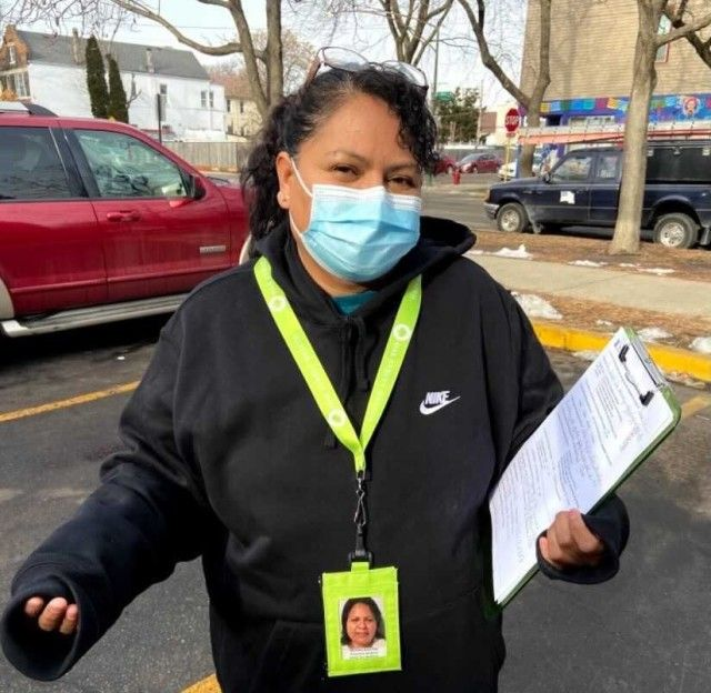 Martina Sanchez, a promotora de salud, stands outside a Back of the Yards laundromat where she shared information with and fielded questions from residents about COVID-19. Image byMaría Inés Zamudio / WBEZ News.
