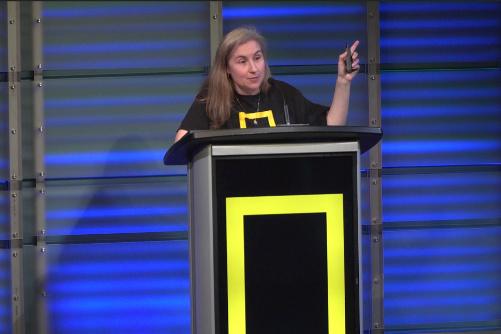Managing Editor of National Geographic Explorer Brenna Maloney describes the experiences of National Geographic reporters in various parts of the world. Image by Claire Seaton. United States, 2019.