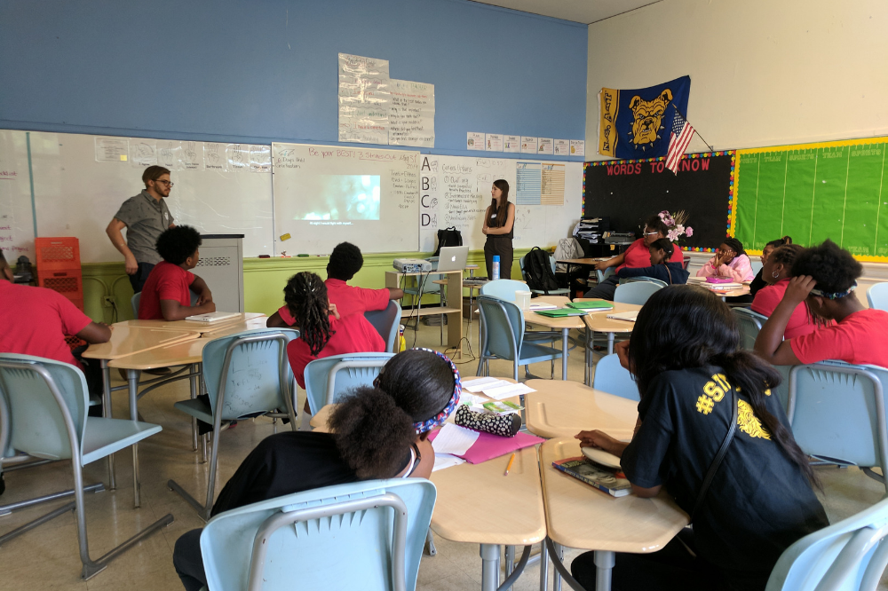Dominic Bracco and Education Coordinator Hannah Berk speak with students at Center City PCS Capitol Hill about their narrative scripts. Image by Devani Lemmon. United States, 2019.